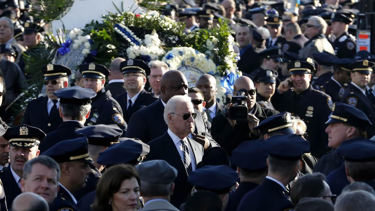 U.S. Vice President Joe Biden arrives for funeral services for NYPD Officer Rafael Ramos at Christ Tabernacle Church, in the Glendale section of Queens, Dec. 27, 2014. (AP Photo)