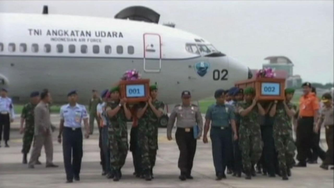 The recovered bodies from AirAsia were carried in coffins.