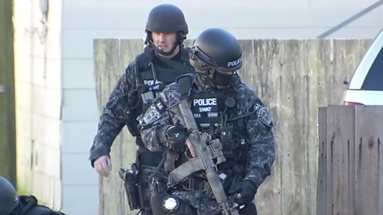 SWAT teams are brought into South San Francisco to help police find a gunman they say fired on two officers.