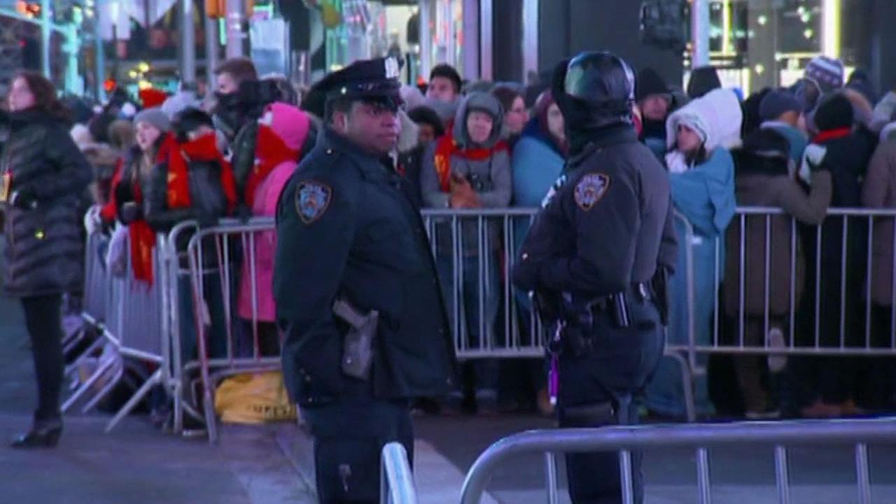 Two police officers monitor the crowds at the New Years Eve in NY