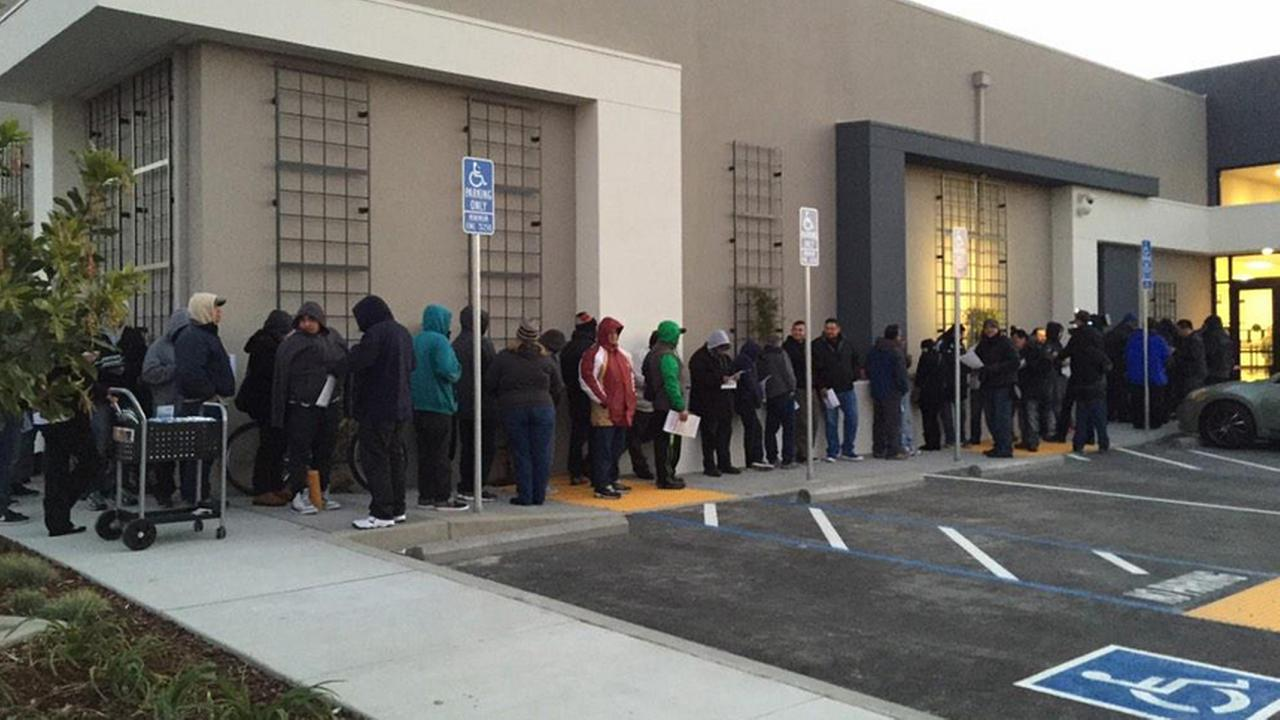 A line stretched around the DMV processing center in San Jose on Friday, the first day undocumented immigrants in California could apply for a state drivers license.