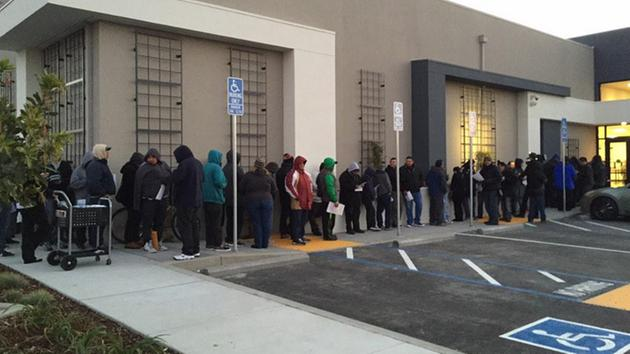 Illegal immigrants line up before dawn for California driver's licenses.