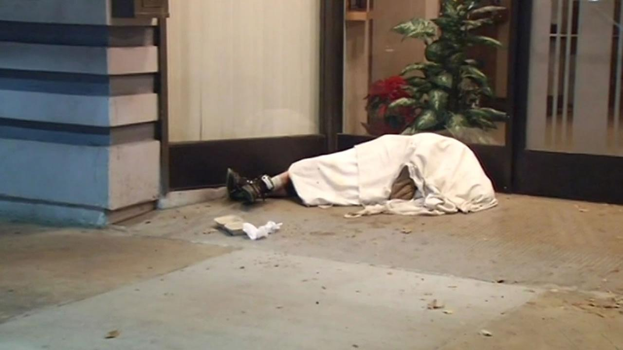 homeless person sleeping in the cold in the East Bay