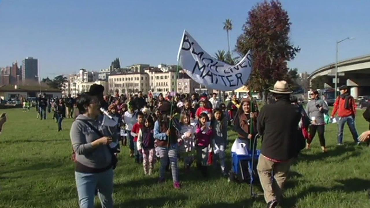 Parents and their children marched in Oakland Sunday to turn the recent anti-police brutality protests into a teaching moment.