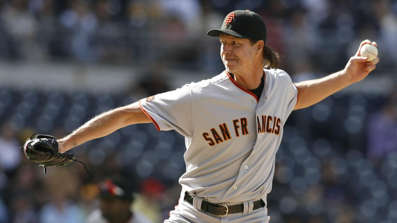 San Francisco Giants pitcher Randy Johnson delivers during the seventh inning of a baseball game against the San Diego Padres in San Diego, Oct. 4, 2009. (AP Photo/Denis Poroy)
