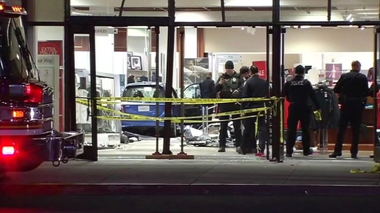 blue Honda Fit crashed into the front doors of Macys in the NewPark Mall