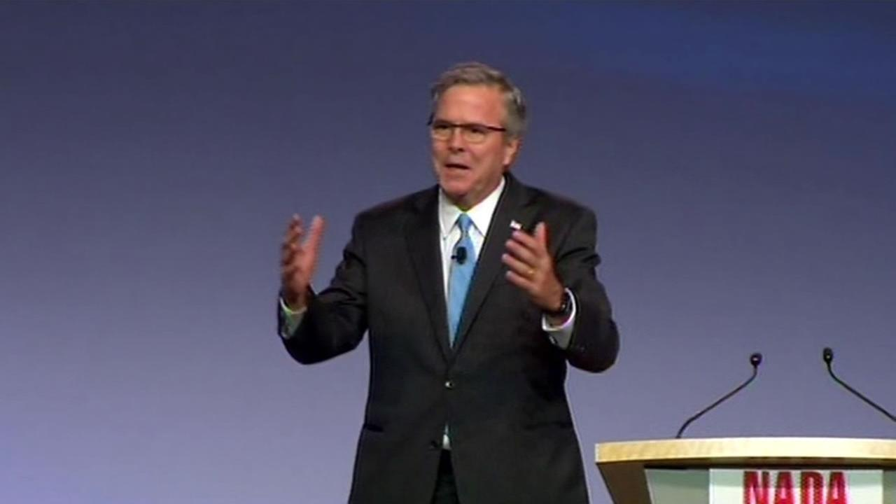 Jeb Bush talks to National Automotive Dealers Association members at a conference in San Francisco.