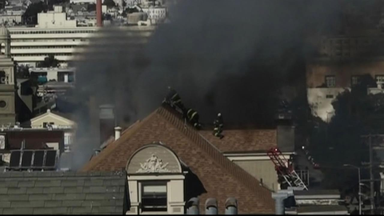 San Francisco firefighters are on the roof tackling a fire on McAllister and Scott Streets in San Francisco.