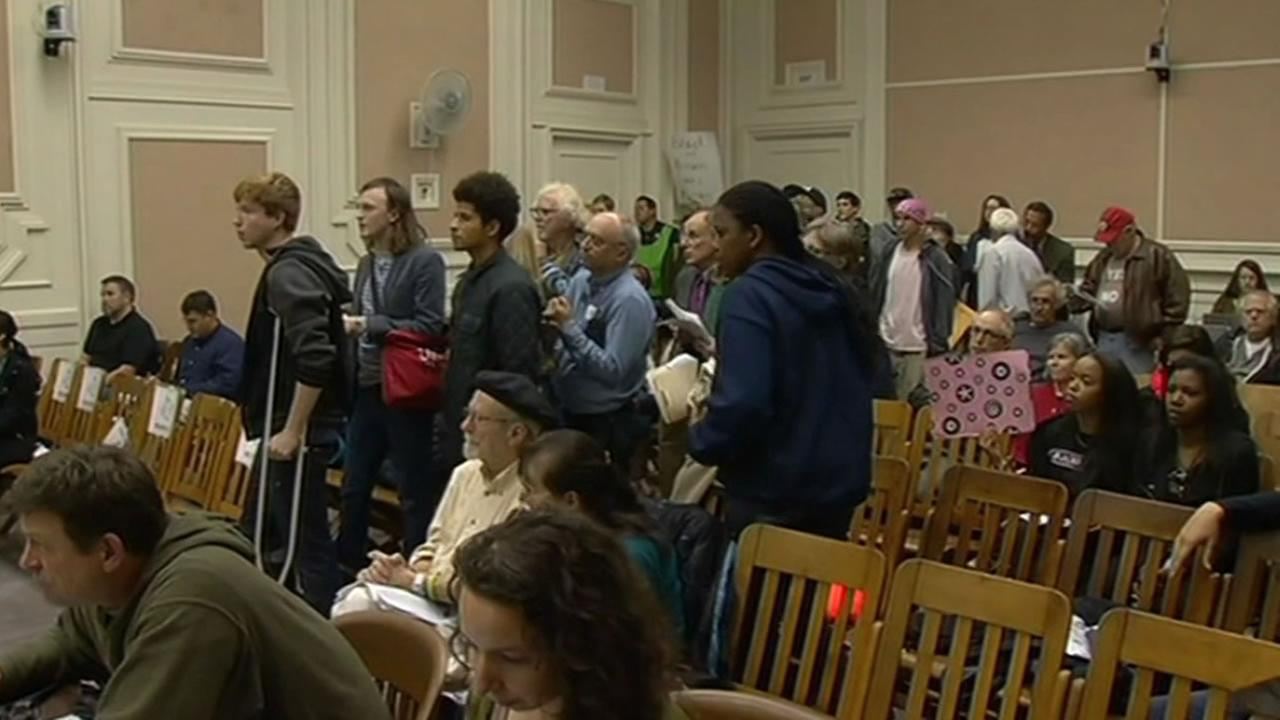 Dozens of protesters packed into a Berkeley City Council meeting