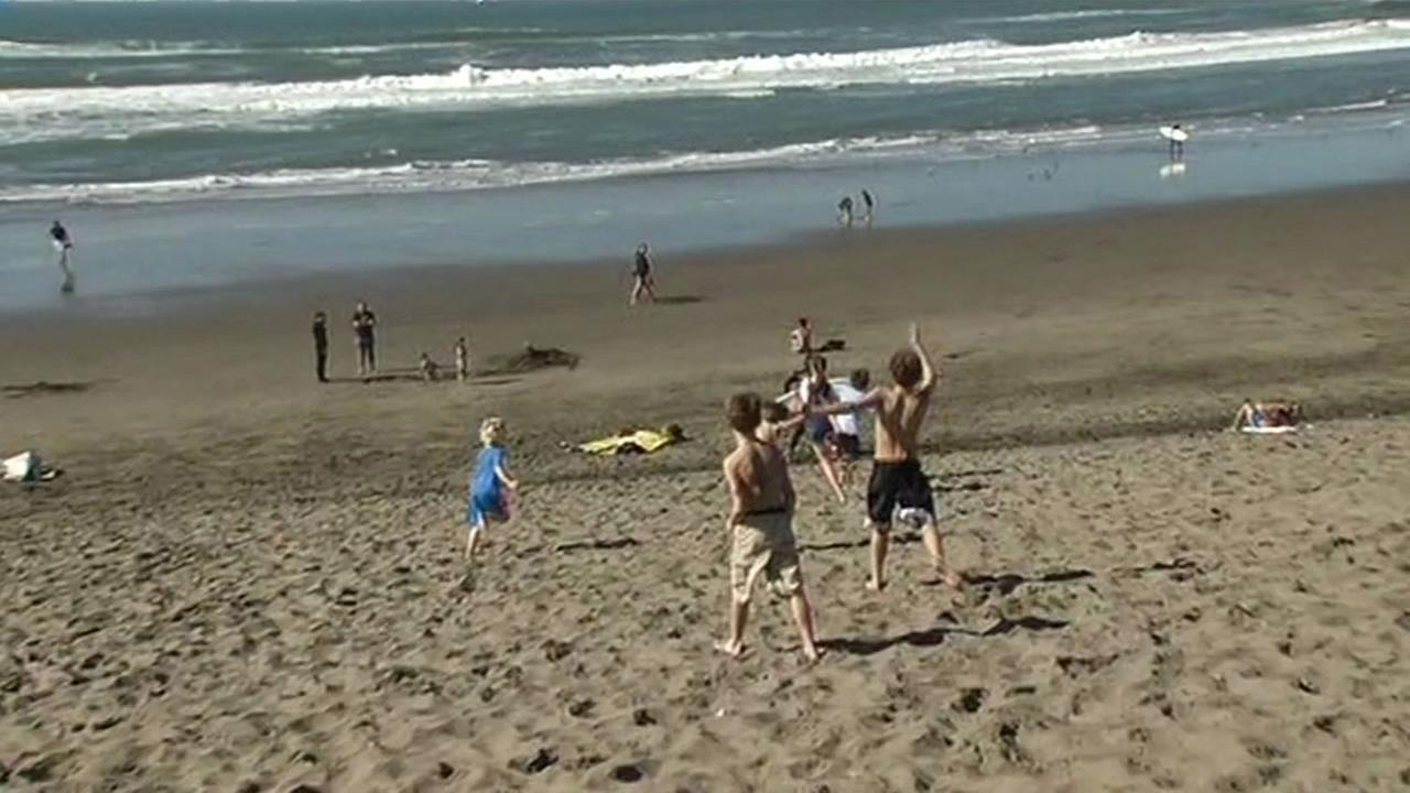 Kids playing at Ocean Beach, San Francisco on Valentines Day 2015.