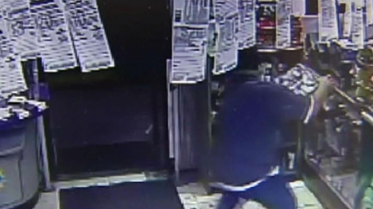 Surveillance video shows a suspect stealing a box of Swisher Sweets