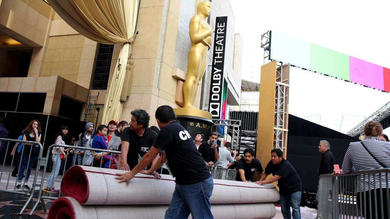 Workers move red carpet as preparations are made for the 87th Academy Awards in Los Angeles, Wednesday, Feb. 18, 2015. (Photo by Matt Sayles/Invision/AP)