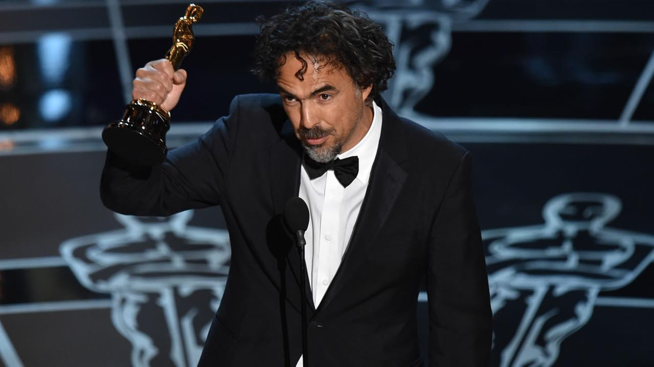 Alejandro G. Inarritu accepts the award for best director for Birdman or (The Unexpected Virtue of Ignorance) at the Oscars on Sunday, Feb. 22, 2015. (AP Photo)