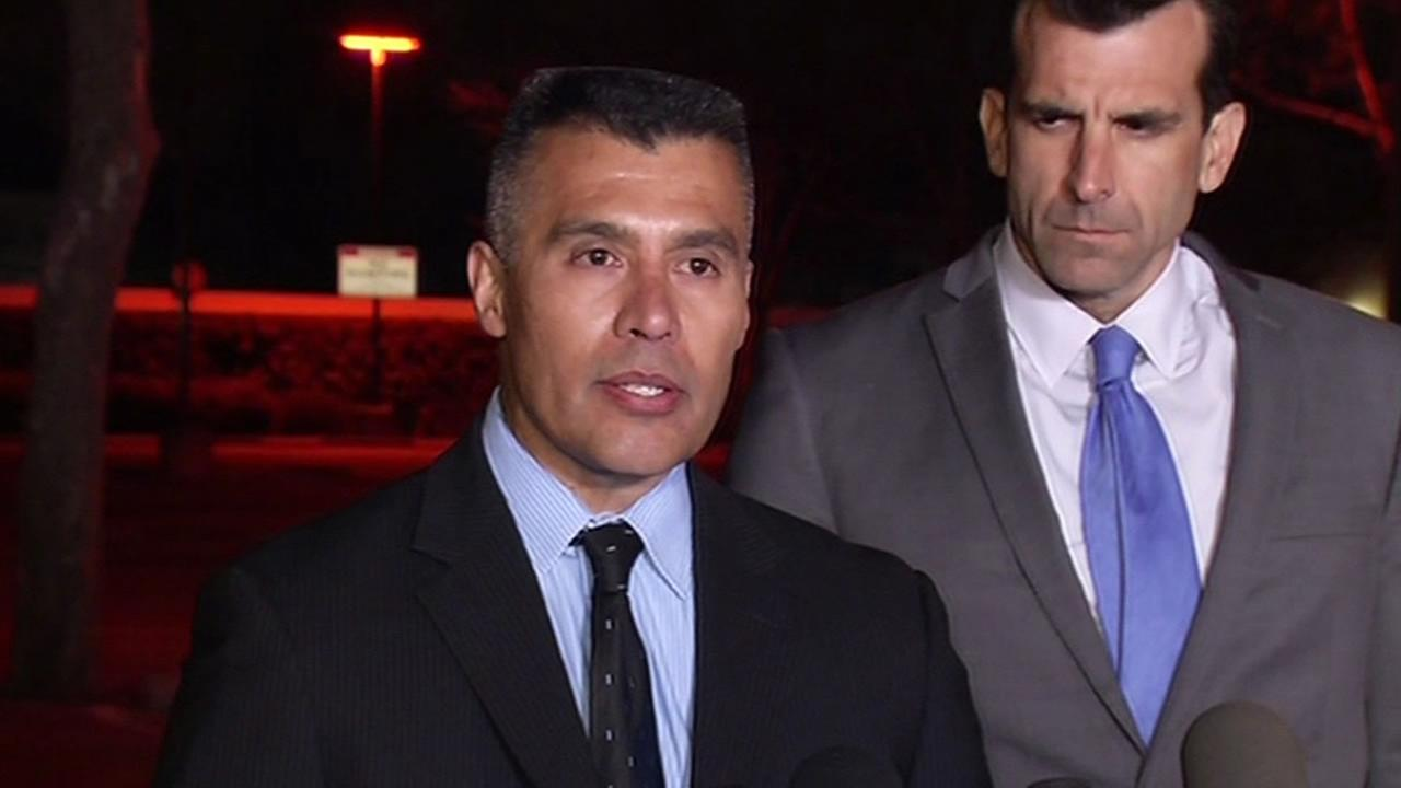 San Jose Chief of Police Larry Esquivel speaks as San Jose Mayor Sam Liccardo stands nearby at a press conference on March 24, 2015. (KGO-TV)