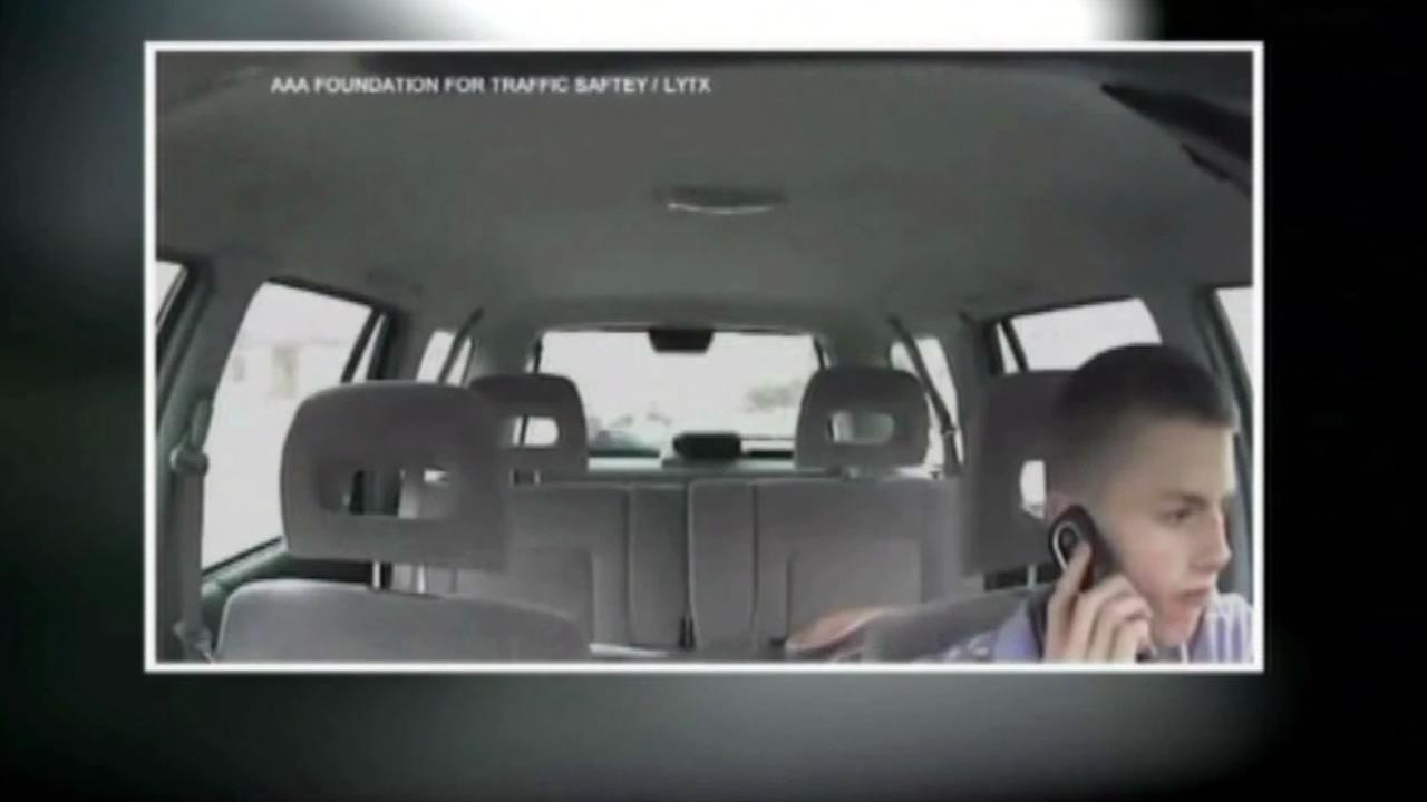 A teemager on the phone while driving.