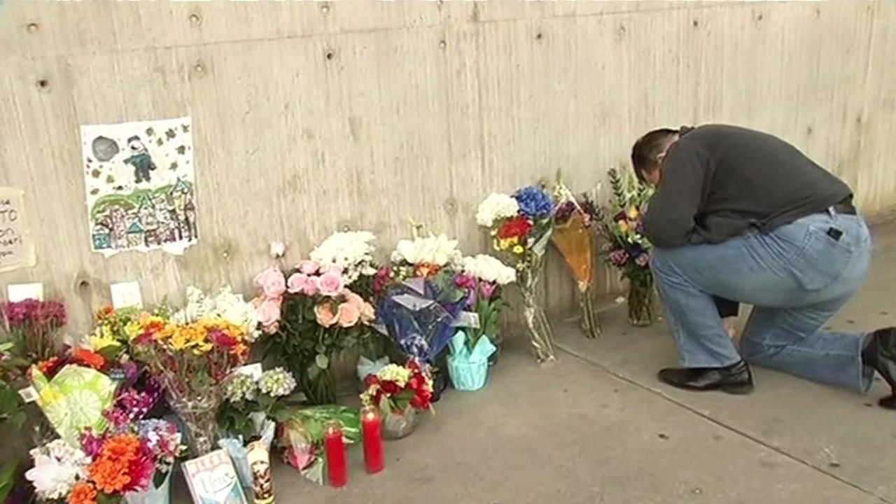 Flowers at San Jose police headquarters for fallen officer Michael Johnson.