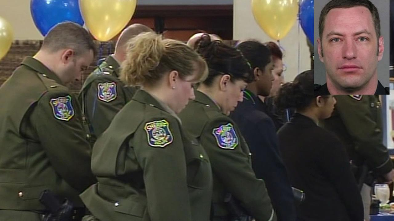 Santa Clara County sheriff deputies have a moment of silence for fallen San Jose police officer Michael Johnson at the San Jose Exchange Club Friday.
