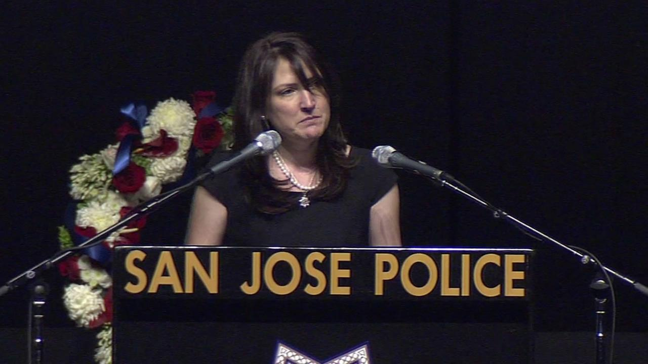 San Jose Police Officer Michael Johnsons sister, Jamie Radack, speaks at his memorial service.