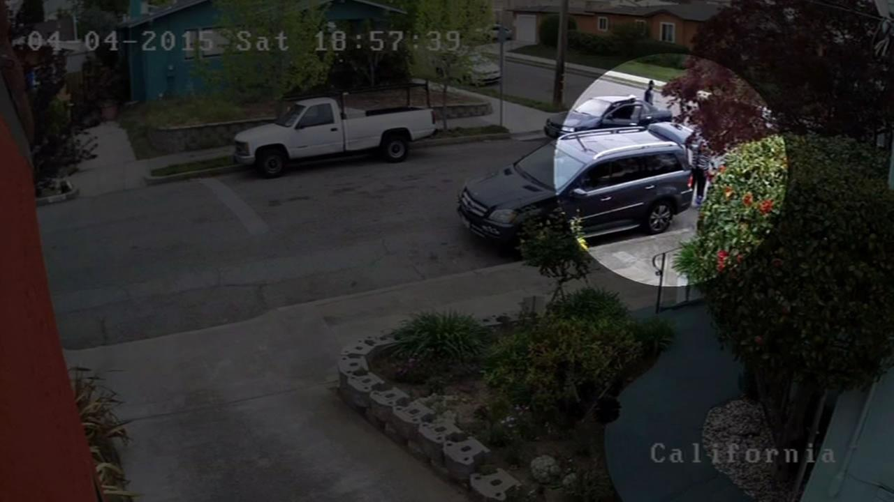 Surveillance video captures an elderly woman being robbed and dragged by a car in Oakland.