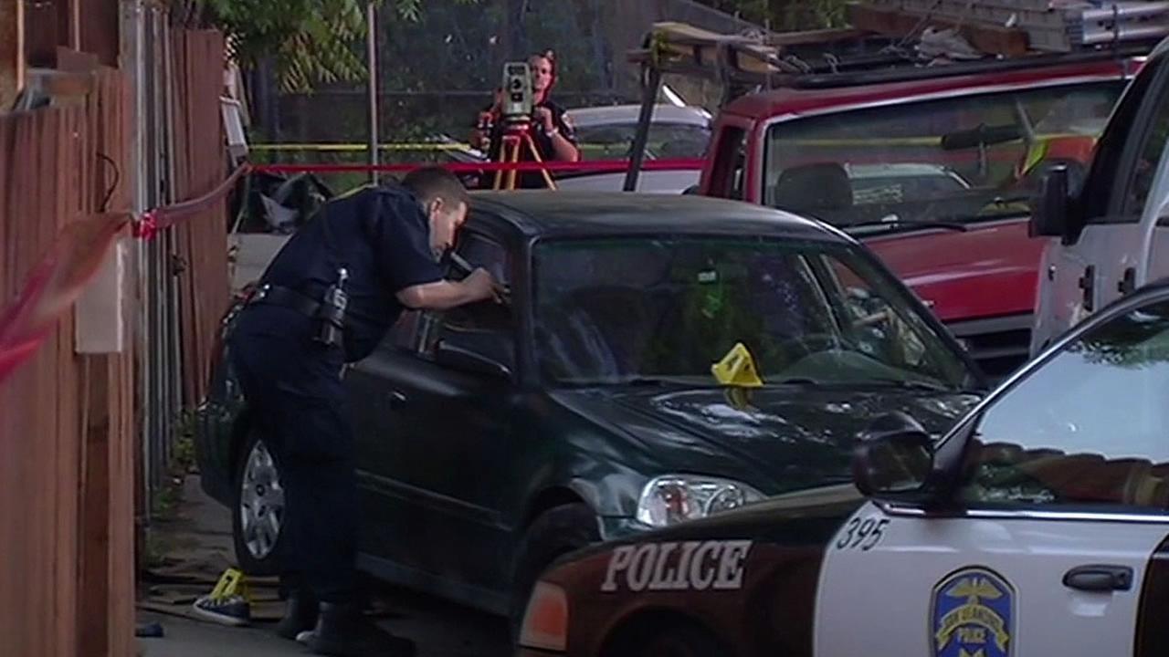 police officer investigates stolen vehicle