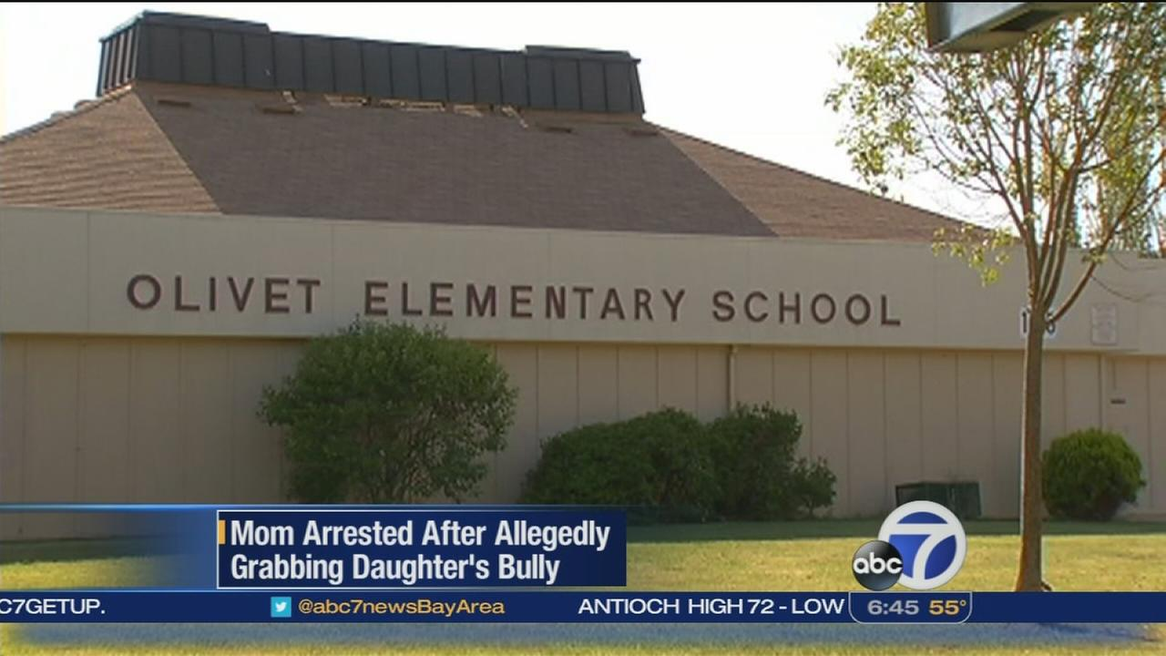 Mom arrested after allegedly grabbing daughters bully