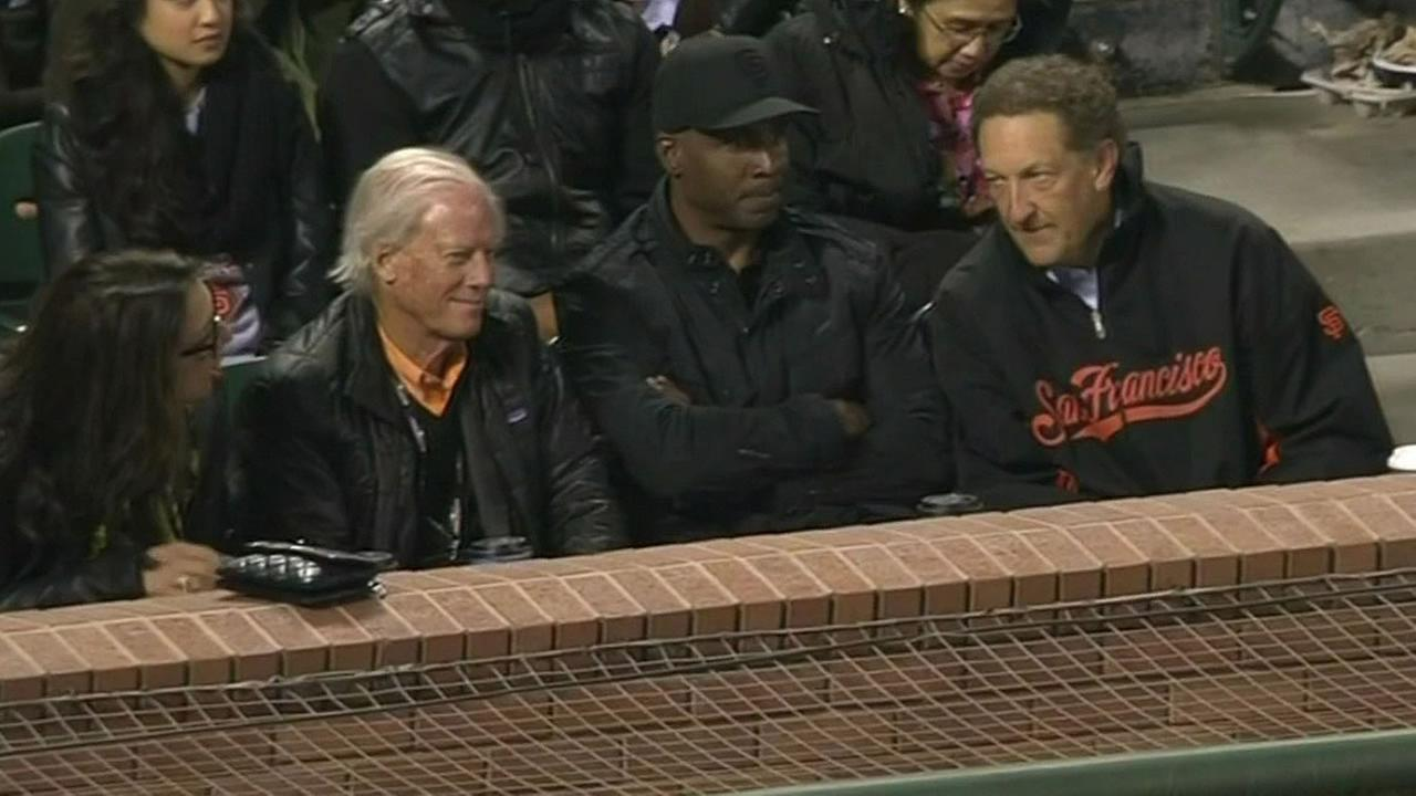 Barry Bonds sits at a Giants game