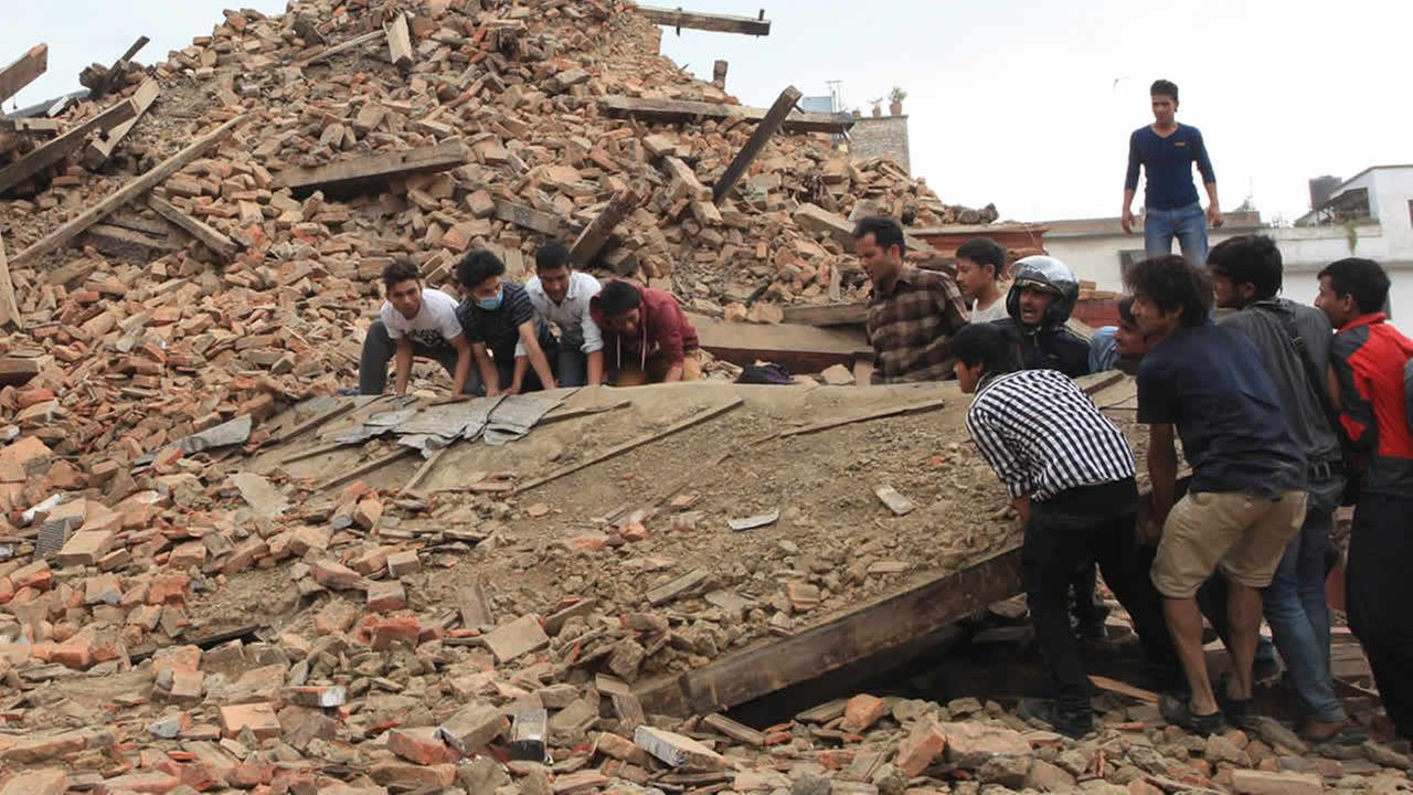 People try to lift the debris from a temple at Hanumandhoka Durbar Square after an earthquake in Kathmandu, capital of Nepal, Saturday, April 25, 2015. (Sunil Sharma/Xinhua via AP)
