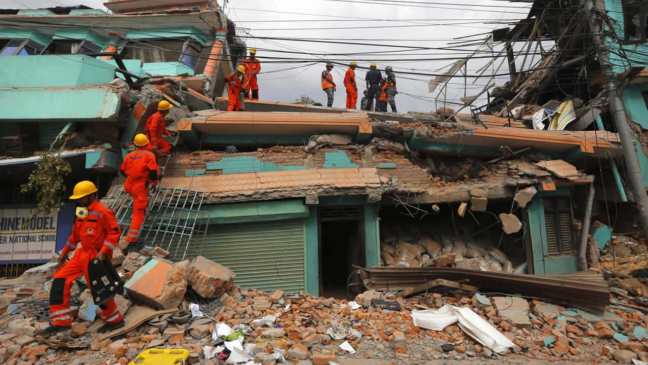 Indias National Disaster Response Force personnel look for survivors in a building, in Kathmandu, Nepal, Sunday, April 26, 2015.  (AP Photo/Manish Swarup)