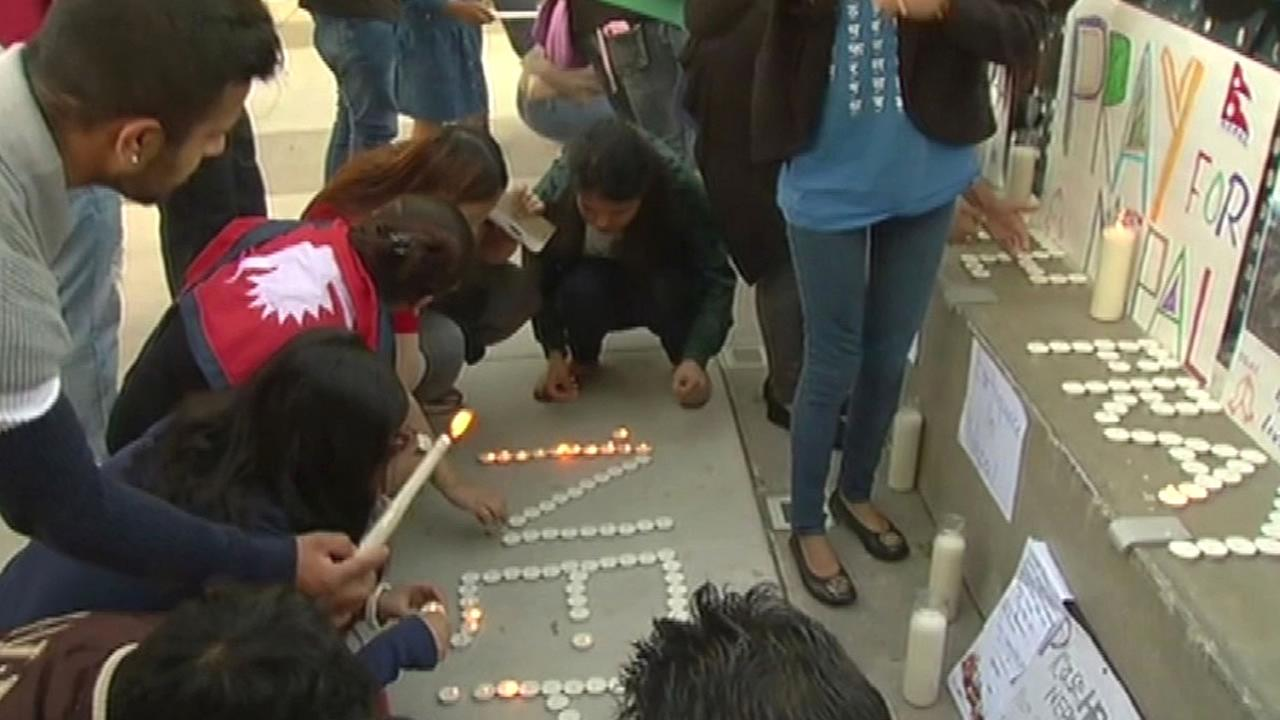 People light candles for Nepal quake victims