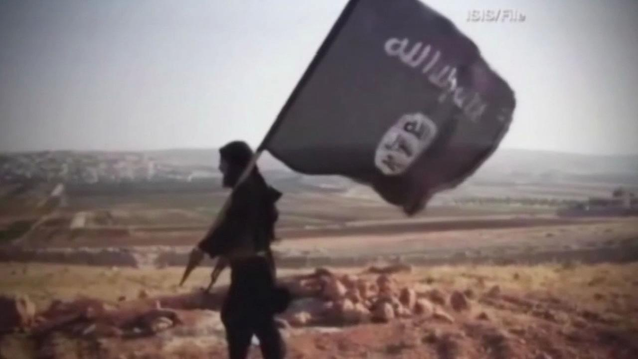 ISIS member waving a dark flag