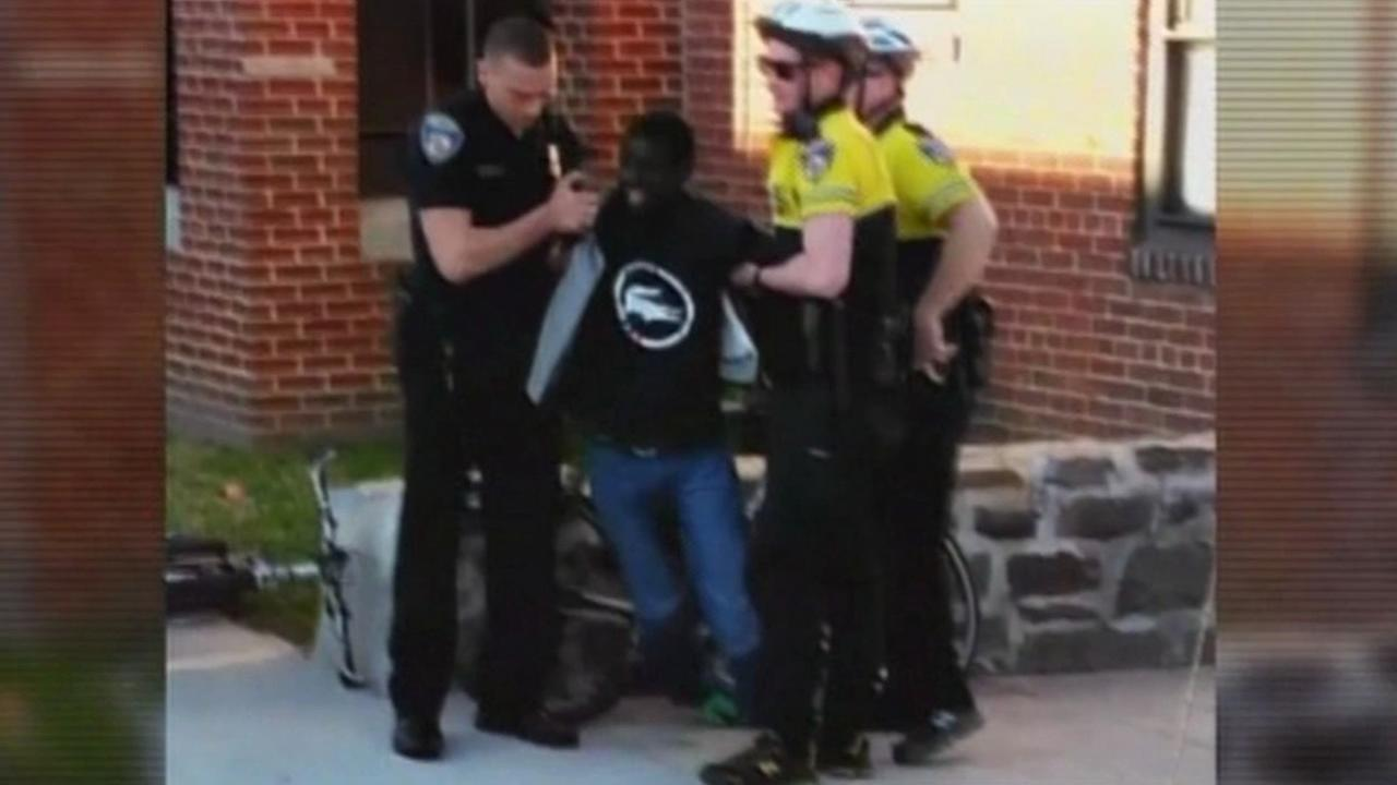 Freddie Gray with officers
