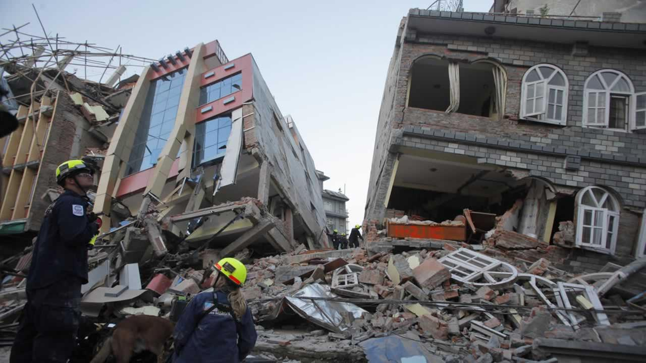 USAID rescue workers inspect the site where buildings collapsed in an earthquake in Kathmandu, Nepal, Tuesday, May 12, 2015. AP Photo/Bikram Rai