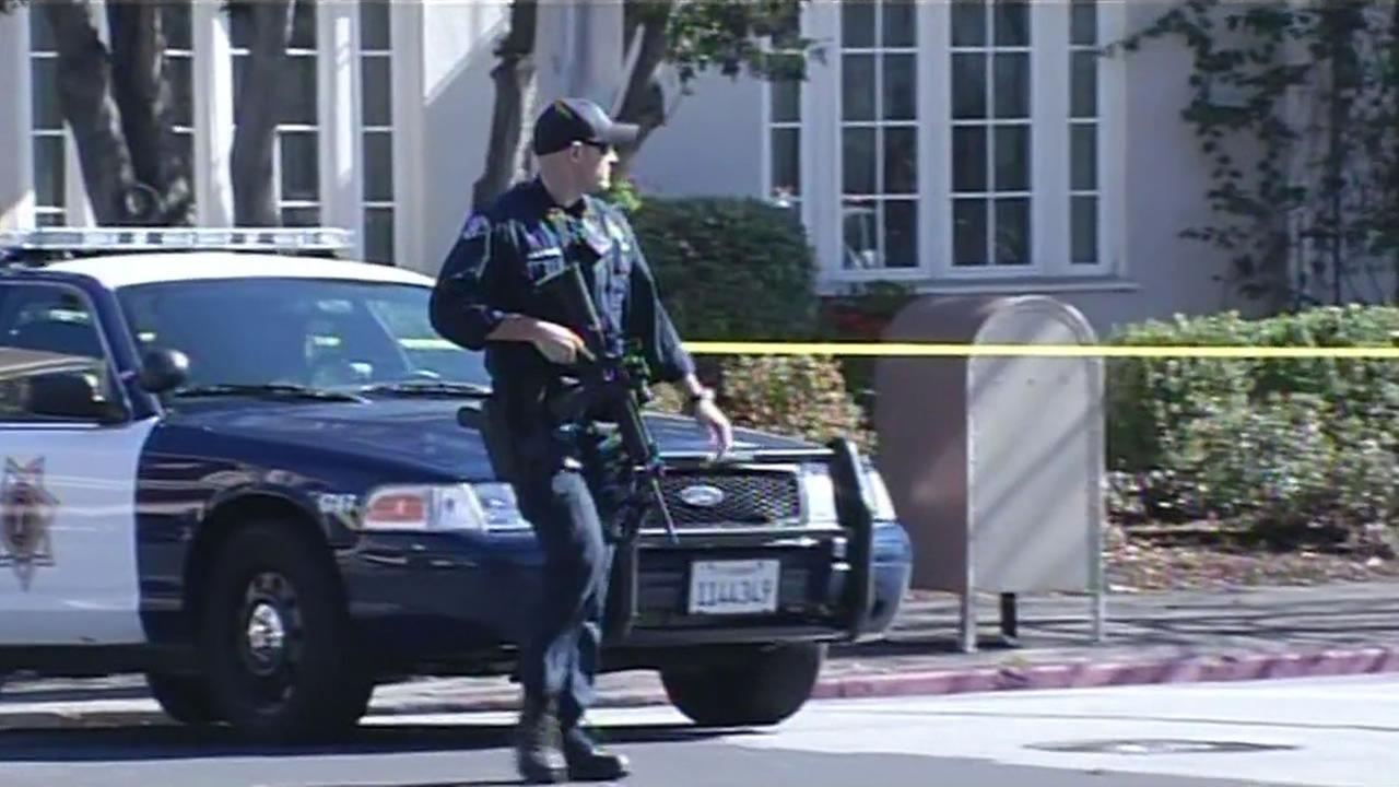 An armed San Jose State University holds walks on campus at the scene of fatal police shooting.