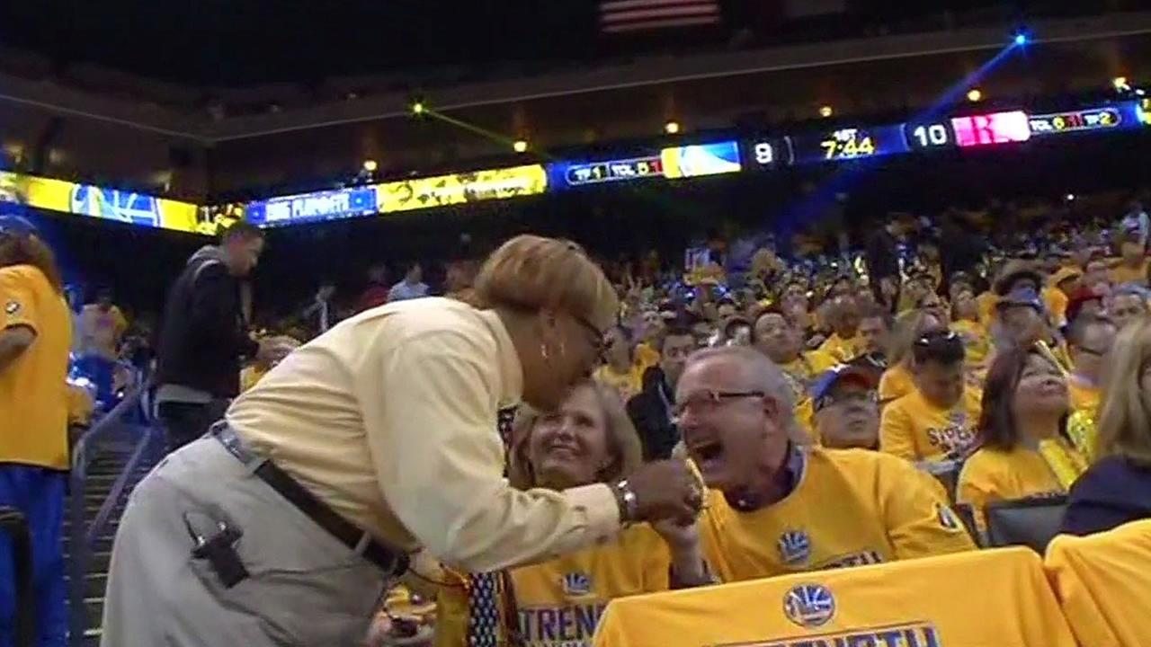 usher Joyce Ford laughs with a Warriors fan