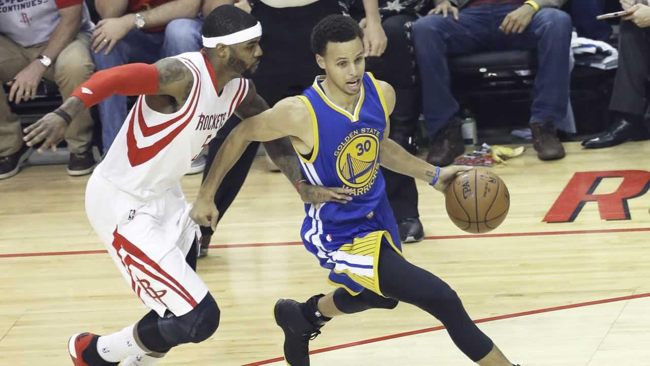 Golden State Warriors Stephen Curry (30) is pressured by Houston Rockets Josh Smith (5) in the first half of an NBA western conference championship basketball game May 23, 2015.