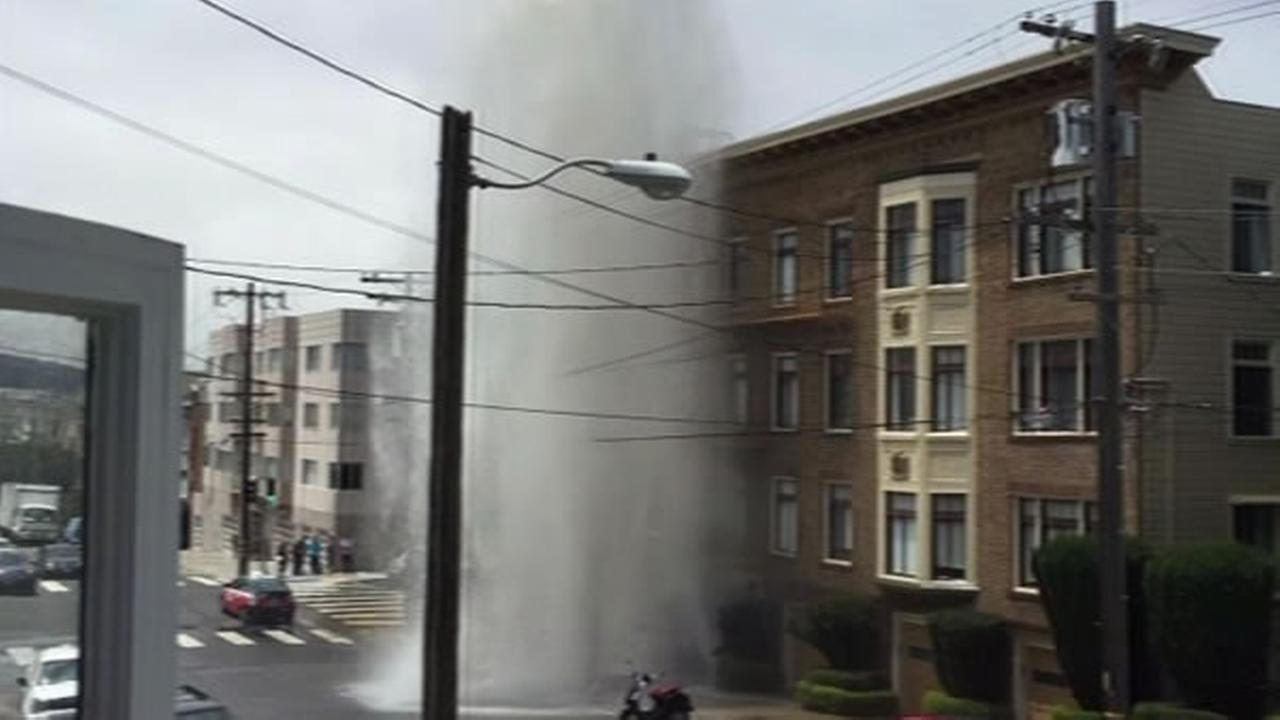 A fire hydrant caused water damage to apartments after it was hit by a car in San Francisco on Saturday, May 30, 2015.