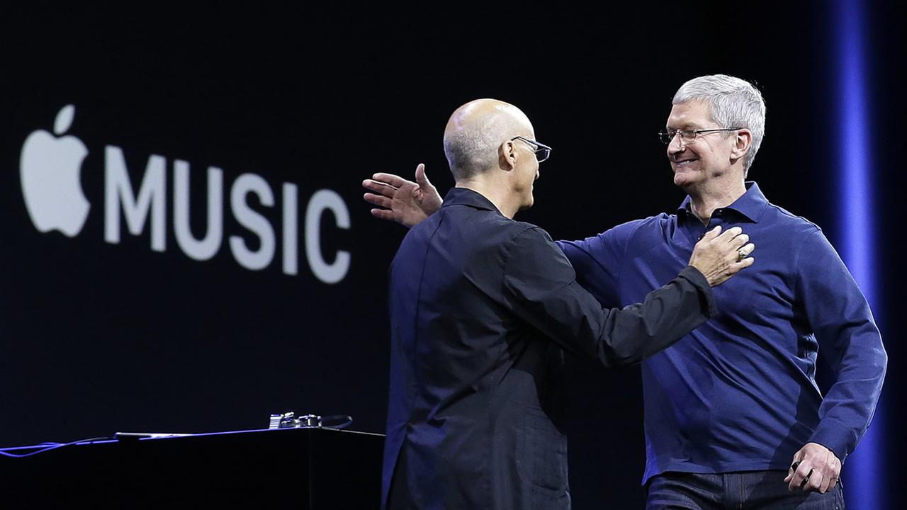 Apple CEO Tim Cook, right, hugs Beats by Dre co-founder and Apple employee Jimmy Iovine at the Apple Worldwide Developers Conference in San Francisco, Monday, June 8, 2015.