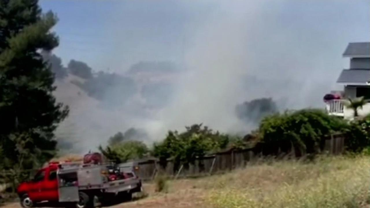 At least two structures were damaged after a 3-alarm brush fire broke out near Blue Rock Springs Creek in Vallejo on Saturday, June 13, 2015.