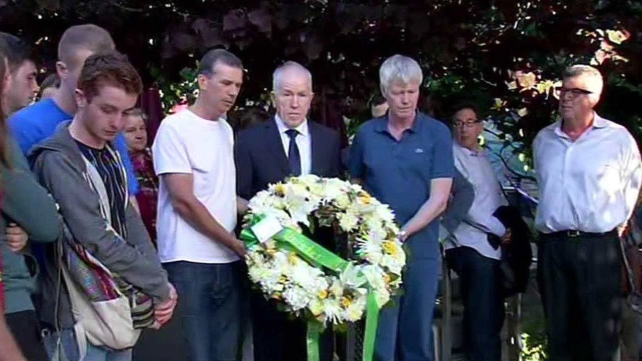 Irelands Minister Jimmy Deenihan, TD lays a wreath at the site of the balcony collapse