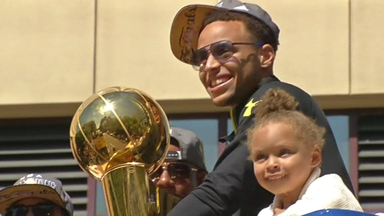 Golden State Warriors guard Stephen Curry and his daughter, Riley, at the Golden State Warriors Victory Parade