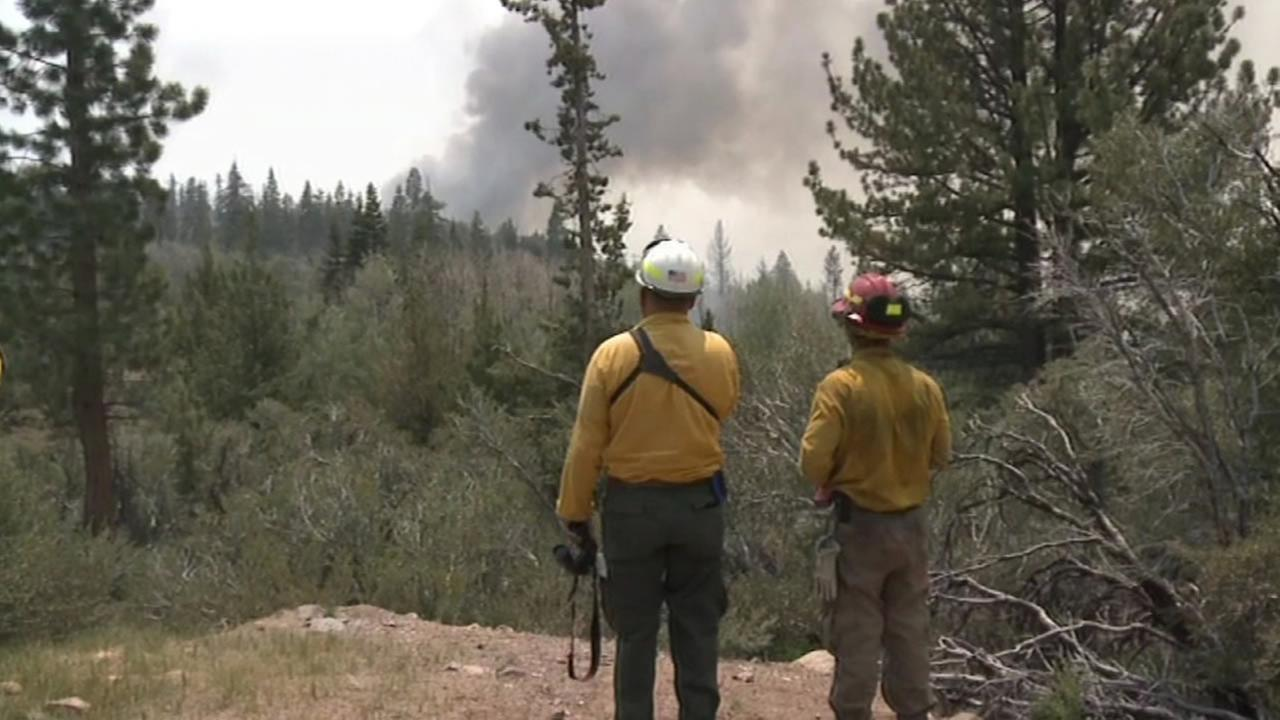 Crews are battling a wildfire that has grown to 26 square miles in hazardous and inaccessible terrain south of Lake Tahoe on Wednesday, June 24, 2015.