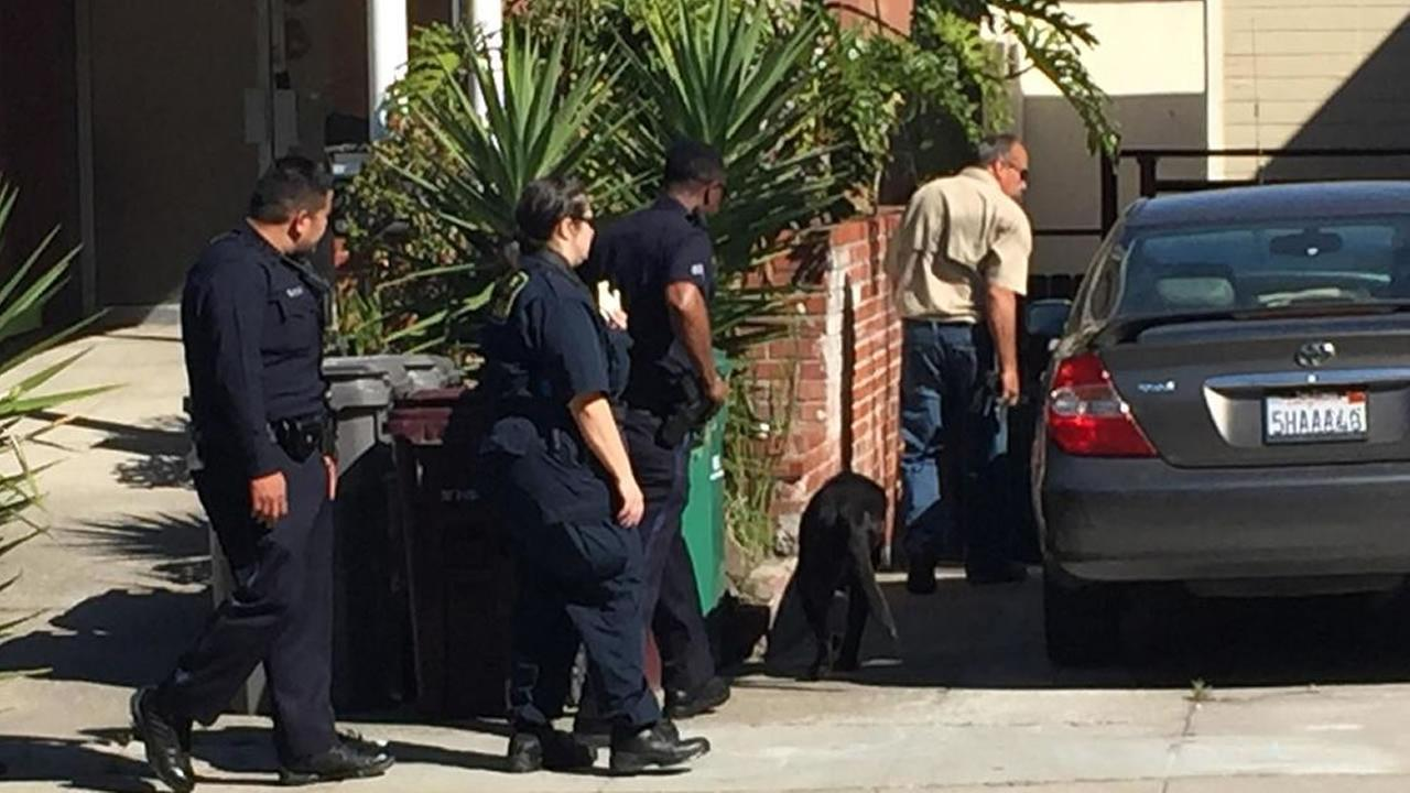 Paul Dostie shows Oakland police officers what his dog found
