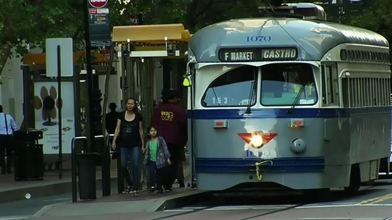 Passengers get off a Muni bus in San Francisco on Wednesday, July 1, 2015.
