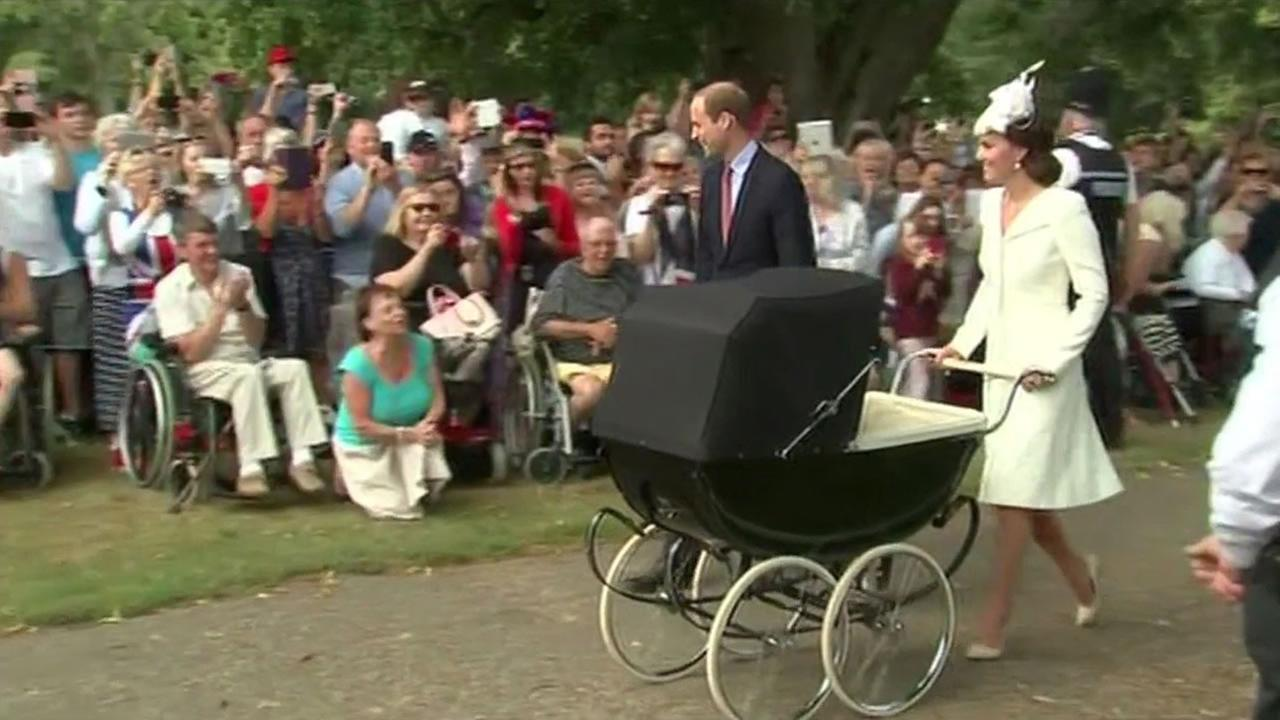 Britains Prince William, Kate the Duchess of Cambridge, their son Prince George and daughter Princess Charlotte in a pram arrive for Charlottes christening.