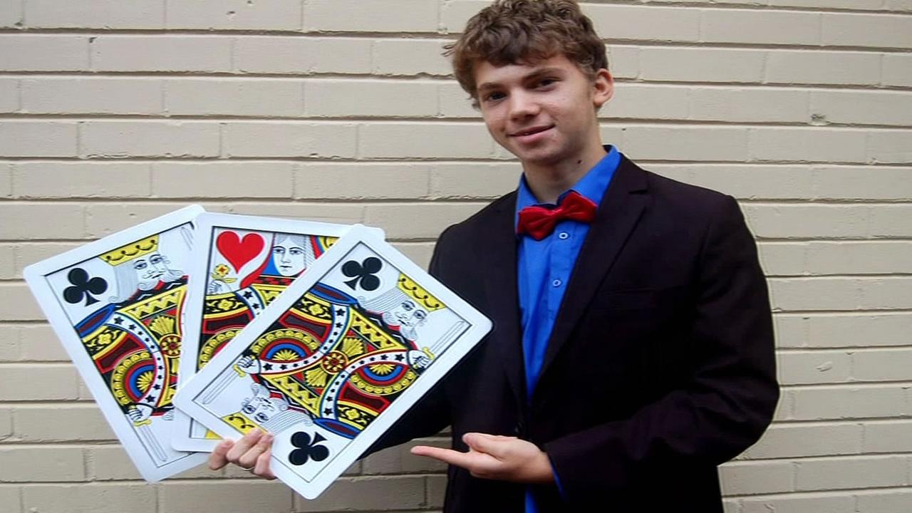 ABC7 Star Scholar Daniel Rosenthal holds magic cards