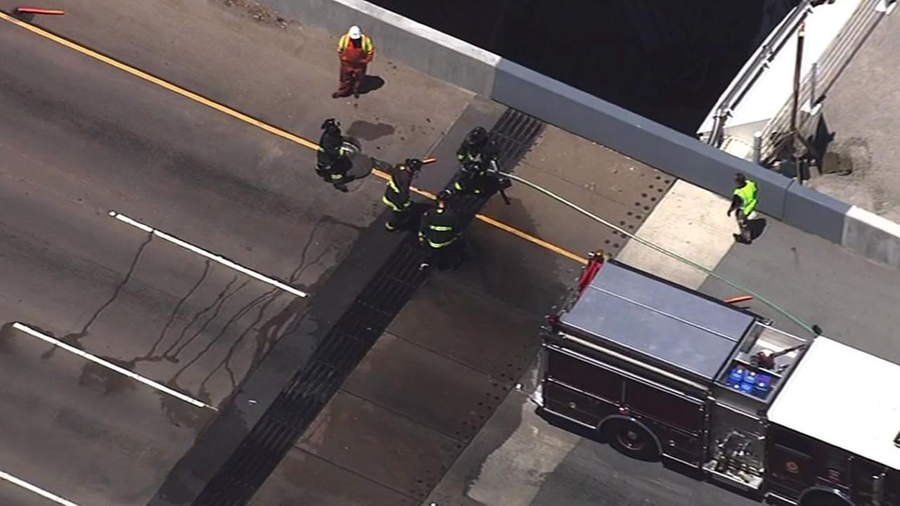 Firefighters put out flames on Bay Bridge