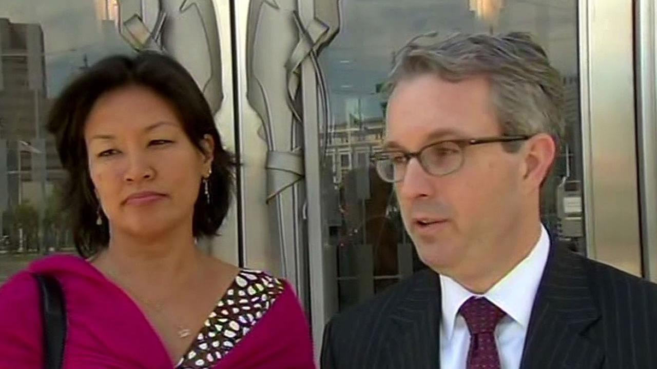 Dr. Mimi Lee stands with her lawyer Peter Skinner