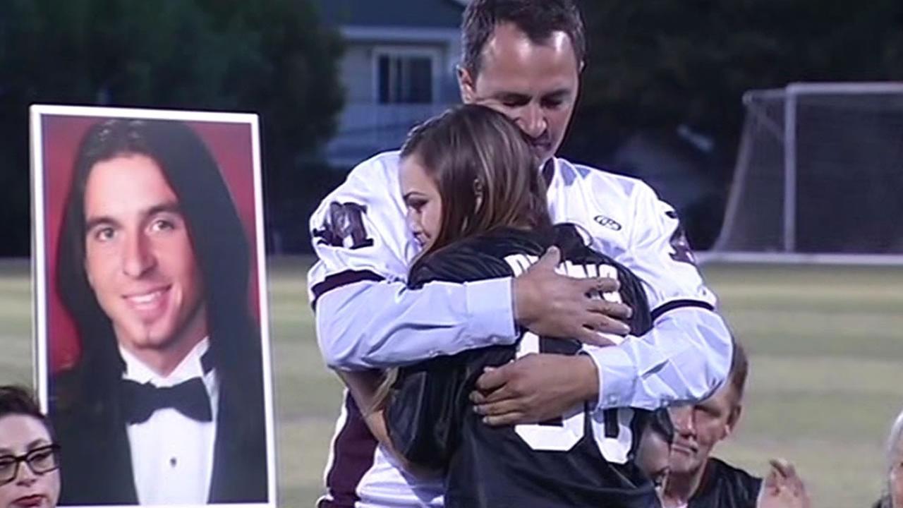 John Deming Sr. gives a hug at his sons memorial gathering
