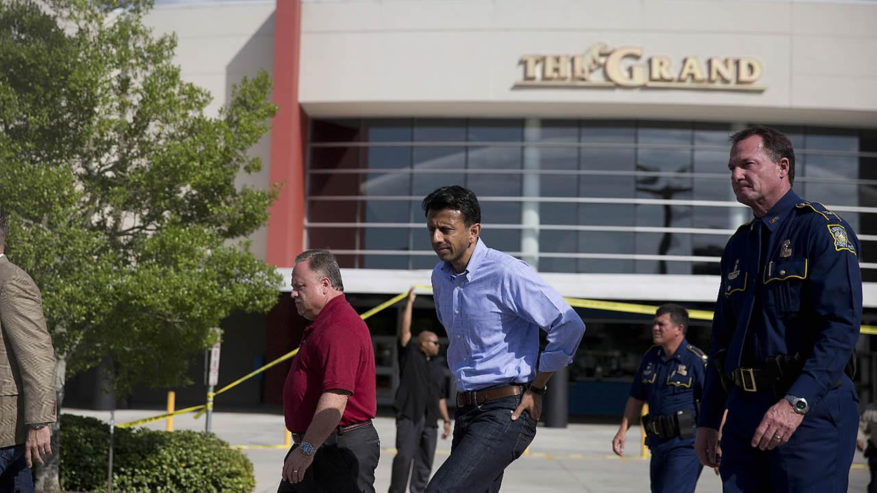 Louisiana Gov. Bobby Jindal, center, walks to deliver a statement following a deadly shooting at the Grand 16 theater, Friday, July 24, 2015, in Lafayette, La.