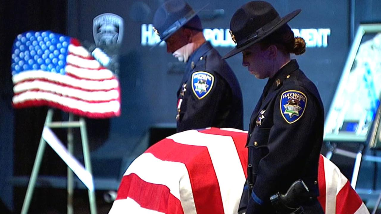 flag draped coffin of Sgt. Scott Lunger